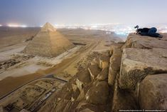 Cairo city lights seen from the top of Cheops Pyramid, Egypt (by Vadim Mahora).