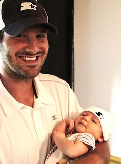 Proud papa Tony Romo and son Hawkins in matching clothes!