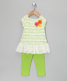 Charming cap-sleeves and a generously ruffled hem conspire to make this comfy cotton-blend creation a lucky girl's favorite frock. Pair it with the included leggings for a look that's playful, sweet and cozy. Includes dress and legsDress: polyester / spandexLeggings: 55% cotton / 37% polyester / 8% spandex