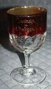 1899 Ruby Stained Honeycomb Water Goblet