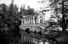 The Marble Bridge at Tsarskoe Selo, 1910.In the Landscape Park (the Catherine Park), near the Great Pond, stand the Marble or Palladian Bridge, also known as the Siberian Marble Gallery. The bridge spans the narrow water course that links the Great Pond with several others dug in 1769–70.