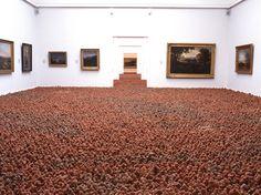 A Massive Field of 200,000 Clay Figures - Antony Gormley