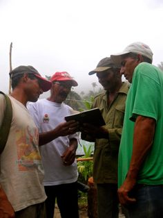 FOUR OF MY GUIDES SHARING A MOMENT, WITH MY DIARY OF SKETCHES