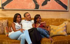 President Barack Obama and his daughters, Malia, left, and Sasha, watch on television as First Lady Michelle Obama takes the stage to deliver her speech at the Democratic National Convention, in the Treaty Room of the White House, Tuesday night, Sept. 4, 2012.