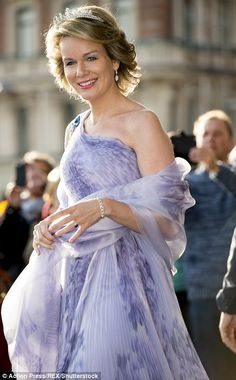 A vision in lilac:Queen Mathilde chose an off-the-shoulder pleated dress for the glamorou...