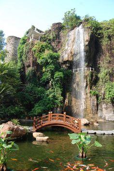 A waterfall and coy fish lake in Guangzhou, China. Guangzhou Waterfall by ash8184.deviantart.com on @deviantART