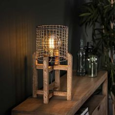This industrial table lamp has a round shape frame and is made of solid mango wood. The wooden luminaire gives this table lamp a tough appearance. Industrial Floor Lamps, Industrial Table, Guest Bedroom Home Office, Different Light Bulbs, Retro Lampe, Drop Lights, Decoration, Lighting Design, Ceiling Lights