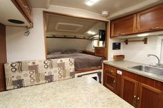 The 2016 Northern Lite 10-2 EX, a non-slide, wet bath truck camper for long bed trucks, http://www.truckcampermagazine.com/news/tcm-exclusive-2016-northern-lite-10-2-ex
