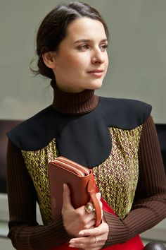 """FAVORITE ACCESSORIES: """"Shoes, as they finish your silhouette and define your attitude and jewelry.""""    Turtle neck and dress LOUIS VUITTON Clutch SMYTHSON Personal jewels       - ELLE.com"""