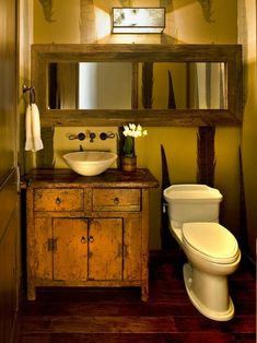 Love the horizontal hung mirror.. Great way to make your small half bath seem larger