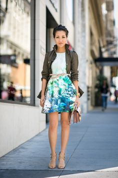 Note the length of skirt. She made it interesting with neutral accessories & a military jacket
