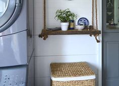 DIY this Hanging Rope Shelf with scrap wood plank, rope and a screw eye hook in the ceiling