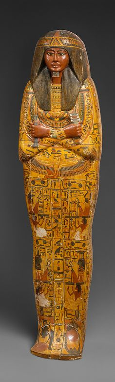 Wooden inner coffin of Khonsu. Inner coffin shows the duplex wig (a double layered wig) with a short goatee. Especially striking are the colours,  the yellow and orange, typical for the 19th dynasty. The goddess Nut is spreading wings protectively under the deceased's chest. Many people incorrectly assume that every winged Egyptian goddess is Isis.
