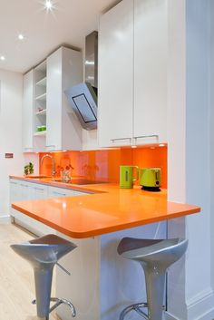 Could you, would you add a hit of bright orange to your #white #kitchen?