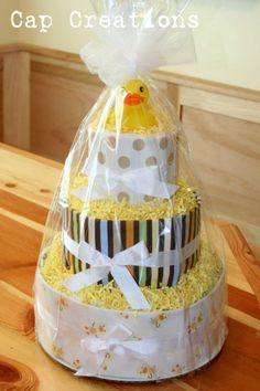 Have you seen these diaper cakes? I've seen them online upwards around $80! Yikes! Wanted to make one for a friend and boy am I happy with t...
