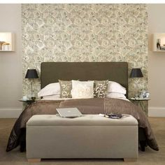 Hotel style bedroom with feature wallpaper.