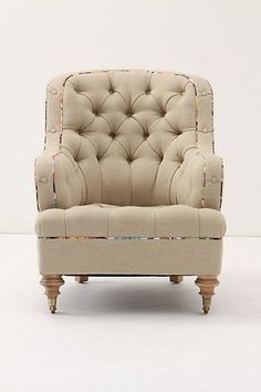 Solid fabric with patterned piping.   Anthro chair upholstered in recycled jute sacks from France.