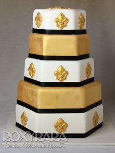 www.RoxyRara.com  Five tier regal white and gold wedding cake with black trim.   To book in for a wedding cake tasting and consultation, email: cake@roxyrara.com
