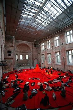 Reddress supported by The Finnish Institute  The performance installation at The York Hall will allow up to 250 audience members to sit in the hem of a giant red dress whilst a performer entertains them from the centre of it.