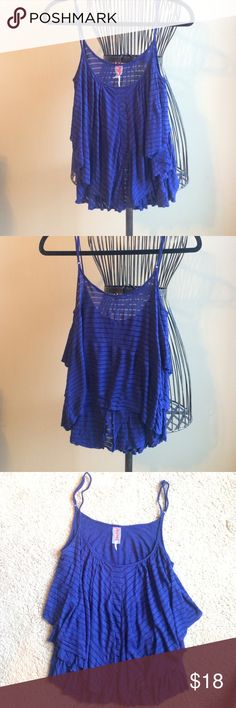 Free People ruffled top Semi cropped, excellent condition, thin cotton and mesh material, adjustable straps. Free People Tops Tank Tops