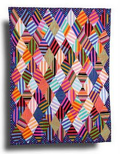 Love all of these stripes in this quilt, in the right place it would be fun art...