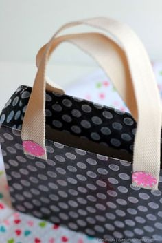 Use a cereal box to make a purse tote Valentine's Day card holder! Super adorable DIY Valentine's Day Card Box holder or candy/treat box idea! Such a cute craft for your kids classroom Valentines party at school! #plaidcrafts #modpodge #applebarrel
