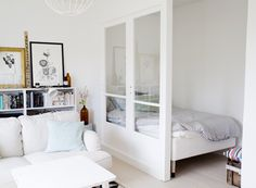 "The challenge: Create a ""bedroom"" (well, at least a bed nook) in an open-layout studio apartment Tiny Studio Apartments, Studio Apartment Layout, Studio Layout, Plan Studio, Studio Decor, Deco Studio, Studio Apt, Tiny Spaces, Small Rooms"