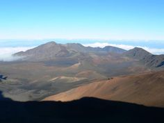 Haleakalā National Park. The Haleakalā volcano on Maui has a very large crater with many cinder cones, Hosmer's Grove of alien trees, and the native Hawaiian Goose. The Kipahulu section has numerous pools with freshwater fish. This National Park has the greatest number of endangered species