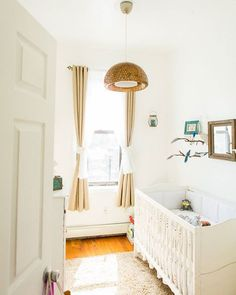 WEBSTA @ smpliving - This shabby chic nursery warms our heart to no end! Wouldn't you want your newborn's bedroom to look like this? | Photography: B Hull | Lighting: @ikeausa | Crib Bedding: Trend Lab | Blue Bird Mobile: Handmade