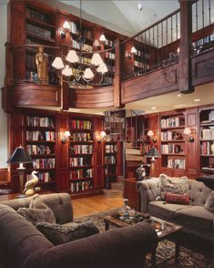 A two story library like this has always been a dream of mine-- except my dream always included a grand piano.