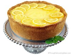 Candied Lemon Cheesecake - Through Her Looking Glass-Candied Lemon Cheesecake. Deliciously sweet and crunchy crust, creamy cheesecake and tangy homemade lemon curd. All garnished with tart candied lemon slices. Best Lemon Dessert Recipe, Lemon Cheesecake Recipes, Pound Cake Recipes, Lemon Desserts, Lemon Recipes, Baking Recipes, Lemon Cakes, Spring Desserts, Cheesecake Cupcakes