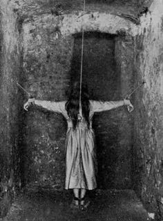 This is an actual picture taken of a lady who is tied in a room of an insane asylum. Some patients were restrained this way......very creepy!