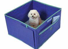 Dog inside indoor dog potty Pack 'N Piddle
