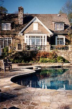 Country House Renovation - natural form pool with landscaping - love the raised planter between pool and retaining wall - very natural