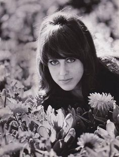 ♡♥Grace Slick relaxes in a bed of flowers♥♡