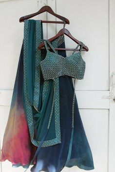 stunning teal blue colored partywear lehenga in crepe silk with matching teal blue color choli and a similar laced nazmeen silk dupatta in teal blue color. Indian Gowns Dresses, Indian Fashion Dresses, Indian Designer Outfits, Indian Outfits, Designer Dresses, Indian Lehenga, Red Lehenga, Anarkali, Simple Lehenga Choli