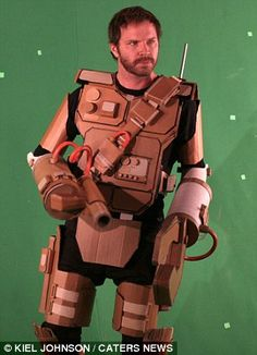 Kiel Johnson - The artist in a robot suit made of cardboard
