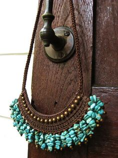 Turquoise crochet necklace.