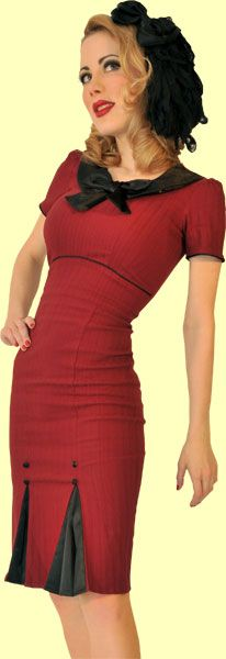 This hot little number is made from a maroon color stretch jacquard fabric. This dress, which has a textured vertical stripe in the fabric, hugs and clings in all the right places.