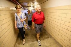 Joyce Brewer Ponder, Renee Whitaker Croy and Terry Ponder walk through the infamous tunnel connecting Central Elementary and the Freshman School during a Fairfield High School Alumni Association open house tour, Saturday, May 28, 2016. GREG LYNCH / STAFF