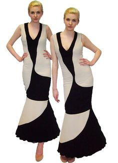 Fitted dress with low cut neck and contrast curve panels with a bell shape bottom continuing contrast curve panels.