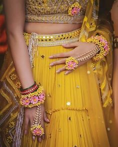gorgeous yellow mirror work mehendi lehenga with pink yellow floral jewellery. Bridal Mehndi Dresses, Bridal Lehenga, Mehndi Dress For Bride, Mehndi Brides, Wedding Dresses, Flower Jewellery For Mehndi, Flower Jewelry, Flower Bracelet, Diamond Jewellery