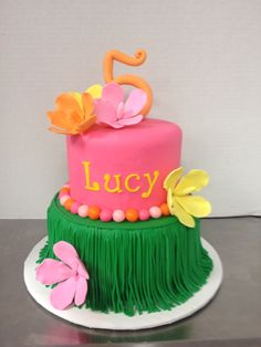 Luau cake in pink, green and yellow with hibiscus. Cake by TracyCakesAR.