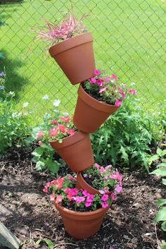 DIY Whimsical Planter   simple to make and perfect in any garden or yard.