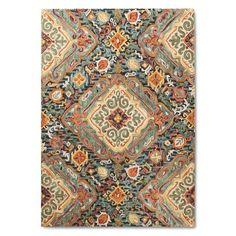 Friends and family will admire your excellent taste when they see the Threshold Valencia Area Rug on the floor in your living room, dining room or den. This indoor rug is a wool blend that feels great for walking on or lying on to watch TV or use your devices. Colorful. Dramatic. Comfy.