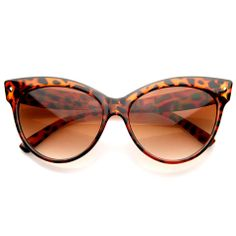 Women's fashion cat eye sunglasses that feature a fun and colorful translucent fade acetate frame with high pointed corners. Made with reinforced metal hinges and UV protected gradient lenses. Measure