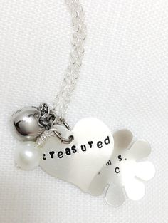 "Teacher Necklace Hand-Stamped with Name and ""Treasured"": Portion of Proceeds to Benefit Those Affected by Sandy Hook Tragedy. $40.00, via Etsy."