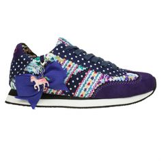 Blue polkadot sneaker with floral ribbons and a dangling pony