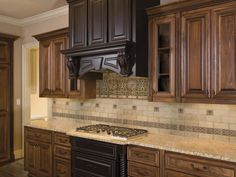 Kitchen, : Exciting Kitchen Decoration Using Cream Granite Countertop Including Cream Stone Tile Kitchen Backsplash And Black Wood Kitchen Vent Hood