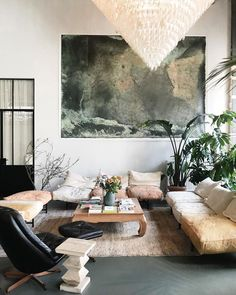 cozy living room idea with statement art, large pendant lighting and mid century modern furniture